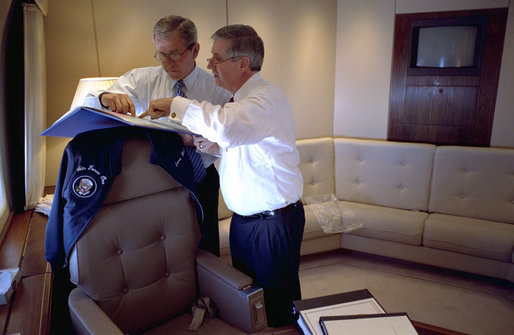 President George W. Bush confers with Chief of Staff Andrew Card aboard Air Force One en route to El Paso in this March 2002 file photo. Tuesday, March 28, 2006, the President announced the resignation of Secretary Card effective in April. White House photo by Eric Draper