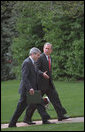 President George W. Bush and Josh Bolten walk up the South Lawn in this April 2001 file photo. Tuesday, March 28, 2006, President Bush named Director Bolten, of the Office of Management and Budget, as Chief of Staff to succeed Andrew Card who will step down in April. White House photo by Eric Draper