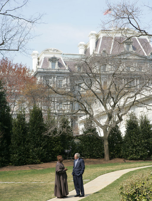 President George W. Bush speaks with Nigerian President Olusegun Obasanjo on the South Lawn Wednesday, March 29, 2006, during his visit to the White House. White House photo by Shealah Craighead
