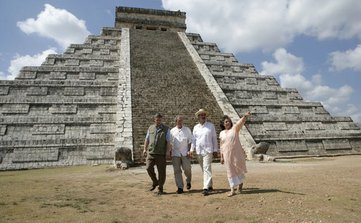 President George W. Bush is flanked by Canada's Prime Minister Stephen Harper, left, and Mexico's President Vicente Fox as they tour the Chichen-Itza Archaeological Ruins Thursday, March 30, 2006, with Dr. Federica Sodi, Regional Director of National Institute of Anthropology and History. White House photo by Eric Draper