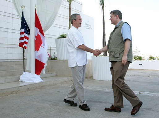 President George W. Bush shakes hands with Canadian Prime Minister Stephen Harper, Thursday, March 30, 2006 in Cancun, Mexico, in their first meeting since Harper was elected Prime Minister. President Bush is participating in a three-day summit with the leaders of Mexico and Canada. White House photo by Kimberlee Hewitt