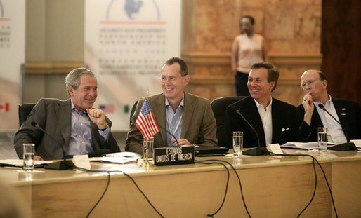 President George W. Bush is seated next to Robert J. Stevens, president and CEO of Lockheed Martin, right, during a meeting with Canadian Prime Minister Stephen Harper and Mexico's President Vicente Fox, in a roundtable discussion with U.S., Mexican and Canadian business leaders, Friday, March 31, 2006 at the Fiesta Americana Condesa Cancun Hotel. White House photo by Eric Draper