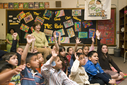 Mrs. Laura Bush sits with Mrs. Jessica Maes's second grade class at Bel Air Elementary School in Albuquerque, N.M., Monday, April, 3, 2006, during a lesson called Protecting You/Protecting Me, to teach the prevention of substance and alcohol abuse. Protecting You/Protecting Me is a curriculum developed and supported by Mothers Against Drunk Driving, for children in grades 1-5, focusing on the effects of alcohol on the developing brain during the first 21 years of life. White House photo by Shealah Craighead
