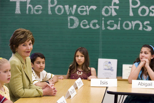 As part of her Helping America's Youth Initiative, Mrs. Laura Bush participates in a round-table discussion with Mr. Jay Pierce's fifth grade class at Bel Air Elementary School in Albuquerque, N. M., Monday, April 3, 2006. The discussion with the children is focused around a curriculum called Protecting You/Protecting Me which teaches children how to protect themselves and make informed decisions regarding alcohol and drugs. White House photo by Shealah Craighead