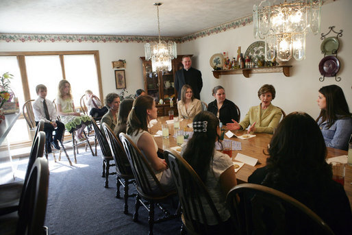Mrs. Laura Bush visits with high school girls who are living in a family-style residential group home at Father Flanagan's Girls & Boys Town in Omaha, NE, Monday, April 3, 2006. The program applies a behavior treatment model for delinquent youths ages 10-18 that emphasizes positive relationships, teaching skills, self control, while supporting moral and spiritual development and promoting self-government and self-determination. White House photo by Shealah Craighead