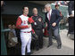 President George W. Bush stands with Reds catcher Jason LaRue and team CEO Bob Castellini during the opening game between the Cincinnati Reds and the Chicago Cubs in Cincinnati, Ohio, Monday, April 3, 2006. White House photo by Eric Draper