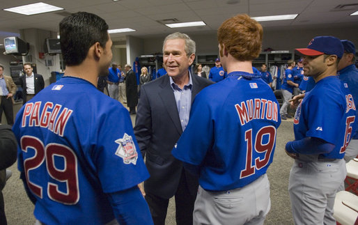 President George W. Bush talks with Cubs outfielders Angel Pagan, left, and Matt Murton before the opening game between the Cincinnati Reds and the Chicago Cubs in Cincinnati, Ohio, Monday, April 3, 2006. White House photo by Eric Draper