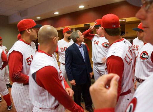 President George W. Bush talks with Reds outfielder and fellow Texan Adam Dunn during a visit with the team before throwing out the first pitch of the opening game between the Cincinnati Reds and the Chicago Cubs in Cincinnati, Ohio, Monday, April 3, 2006. White House photo by Eric Draper