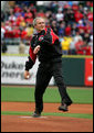 President George W. Bush winds up to throw the first pitch of the 2006 baseball season during the opening game between the Cincinnati Reds and the Chicago Cubs in Cincinnati, Ohio, Monday, April 3, 2006. White House photo by Eric Draper