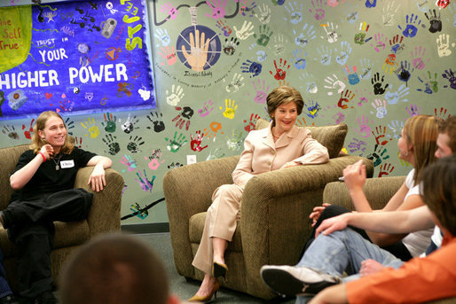 As part of the Helping America's Youth initiative, Mrs. Laura Bush visits the Preferred Family Healthcare Adolescent Substance Abuse Rehabilitation Center, and talks with 18 year-old Dalton Fox about the progress of her recovery from substance abuse addiction on Tuesday, April 4, 2006, in St. Louis, Mo. PFH specializes in individual customer care, by focusing on strengthening individual skills, attitudes, and behaviors that maximizes the opportunity for each person to achieve and maintain recovery. White House photo by Shealah Craighead