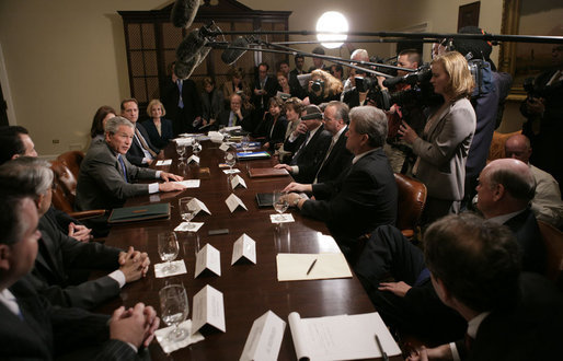 President George W. Bush answers a question from the press as he sits with members of the insurance, banking and business communities Tuesday, April 4, 2006, during a meeting at the White House on Health Care Initiatives. White House photo by Paul Morse