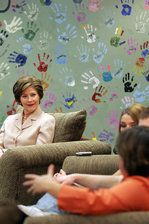 Mrs. Laura Bush listens to Kasey Harlin, Lead Therapist at Preferred Family Healthcare Adolescent Substance Abuse Rehabilitation Center in St. Louis, Mo., Tuesday, April 4, 2006, discuss the benefits that art therapy has had on her clients at the center. White House photo by Shealah Craighead