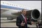 Standing outside Air Force One in Charlotte, N.C., President George W. Bush addresses the media after speaking about the War on Terror at Central Piedmont Community College Thursday, April 6, 2006. White House photo by Paul Morse