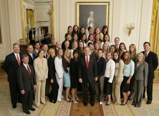 President George W. Bush stands with members of the Auburn University Men and Women's Swimming and Diving Team Thursday, April 6, 2006, during a photo opportunity with the 2005 and 2006 NCAA Sports Champions. White House photo by Paul Morse