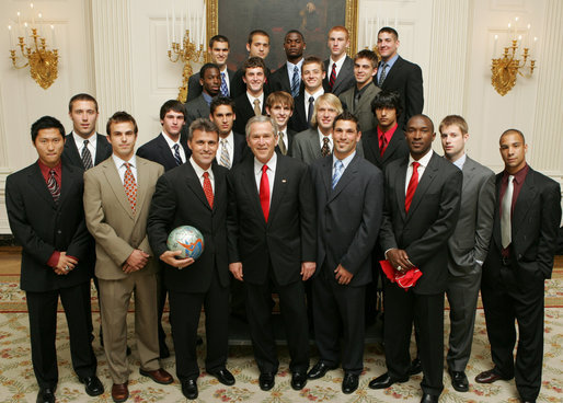 President George W. Bush stands with members of the University of Maryland Men's Soccer Team Thursday, April 6, 2006, during a photo opportunity with the 2005 and 2006 NCAA Sports Champions at the White House. White House photo by Kimberlee Hewitt
