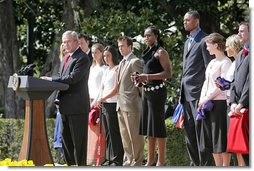 President George W. Bush congratulates the 2005 and 2006 NCAA Championship teams during a South Lawn ceremony Thursday, April 6, 2006. White House photo by Kimberlee Hewitt