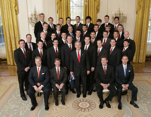 President George W. Bush stands with members of the Auburn University Men's Swimming and Diving Team Thursday, April 6, 2006, during a photo opportunity with the 2005 and 2006 NCAA Sports Champions at the White House. White House photo by Paul Morse
