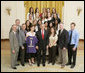 President George W. Bush stands with members of the University of Washington Women's Volleyball Team Thursday, April 6, 2006, during a photo opportunity with the 2005 and 2006 NCAA Sports Champions. White House photo by Paul Morse
