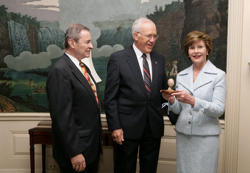 Victor Mooney, American Egg Board Chairman and Louis Raffel, American Egg Board President, present Mrs. Laura Bush with an annual commemorative egg from the American Egg Board Thursday, April 6, 2006 at the White House. The egg shell has been carved to display the Presidential Seal. White House photo by Shealah Craighead