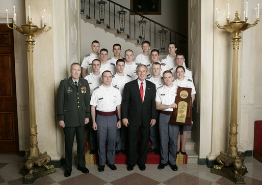 President George W. Bush stands with members of the U.S. Military Academy Rifle Team Thursday, April 6, 2006, during a photo opportunity with the 2005 and 2006 NCAA Sports Champions. White House photo by Eric Draper