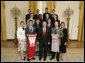 President George W. Bush stands with members of the University of Wisconsin Men's Cross Country Team Thursday, April 6, 2006, during a photo opportunity with the 2005 and 2006 NCAA Sports Champions. White House photo by Paul Morse