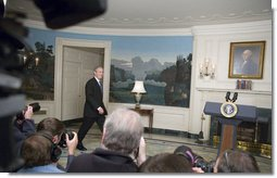 "President George W. Bush walks into the Diplomatic Reception Room where he addressed the press Friday, April 7, 2006. ""Good morning, This morning's economic report shows that America's growing economy added 211,000 jobs in the month of March,"" said the President. ""The American economy has now added jobs for 31 months in a row, created more than 5.1 million new jobs for American workers. The unemployment rate is now down to 4.7 percent -- that's below the average rate of the 1960s, 1970s, 1980s and 1990s."" White House photo by Kimberlee Hewitt"