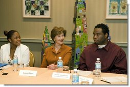 Mrs. Laura Bush listens to Jeremy Greathouse, an unemployed New Orleans youth, and LaToya Dorsha Williams, an Urban League participant, about difficulties of life experiences and employment during a discussion with the National Urban League in New Orleans, La., Monday, April 10, 2006. Urban League affiliate sites are providing youth care-focused employability skills, paid internships, and on-the job training to help participants enter full-time, private sector employment.  White House photo by Shealah Craighead