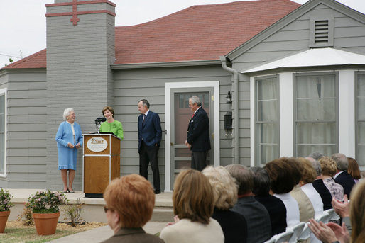 Mrs. Laura Bush, joined by former President George H.W. Bush, Mrs. Barbara Bush, and family friend, Joe O'Neill, speaks to the crowd on Tuesday, April 11, 2006, during a dedication and ribbon cutting ceremony for the opening of President George W. Bush's Childhood Home in Midland, Texas. White House photo by Shealah Craighead