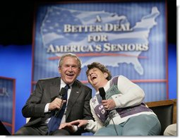 President George W. Bush shares a laugh with panel participant Helen Robinette during a conversation about Medicare prescription drug benefits at the Etta & Joseph Miller Performing Arts Center in Jefferson City, Mo., Tuesday, April 11, 2006.  White House photo by Eric Draper