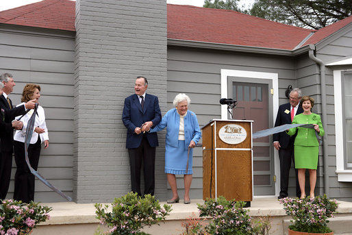 Former President George H.W. Bush and Mrs. Barbara Bush share a laugh with Mrs. Laura Bush and Midland friends, George Scott, Jan O'Neill, and Joe O'Neill, after cutting the ribbon on Tuesday, April 11, 2006, at the dedication of the President George W. Bush's Childhood Home in Midland, Texas. White House photo by Shealah Craighead