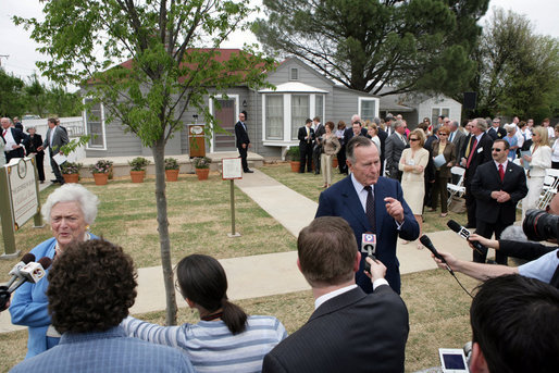 Former President George H.W. Bush and Mrs. Barbara Bush talk with members of the press on April 11, 2006, after the dedication and ribbon cutting ceremony for the opening of President George W. Bush's Childhood Home in Midland, Texas. White House photo by Shealah Craighead