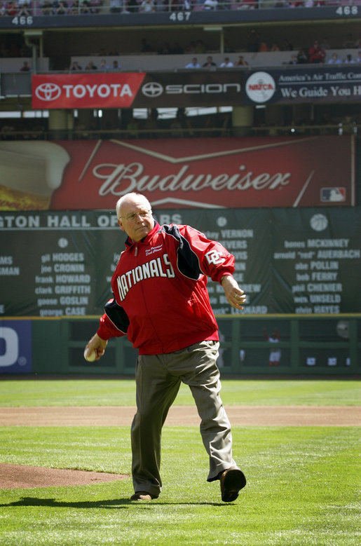 Vice President Dick Cheney winds up to throw the ceremonial first pitch at the Washington National's home opener against the New York Mets at RFK Memorial Stadium in Washington, Tuesday, April 11, 2006. The tradition of the president or vice president throwing out the ceremonial first pitch at a baseball game in Washington D.C. dates back to President Taft in 1910. The last vice president to throw the pitch was Vice President Humphrey in 1968. White House photo by David Bohrer