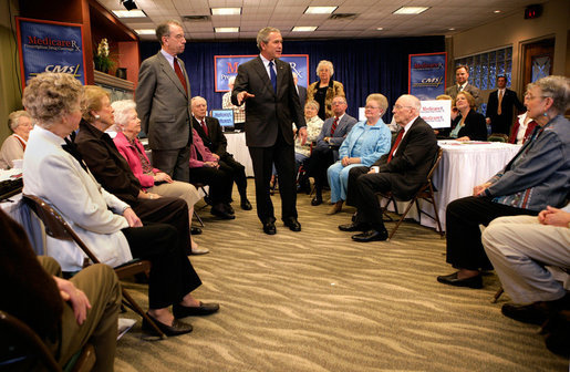 "President George W. Bush and Senator Charles, Grassley, R-Iowa, talk with residents about Medicare prescription drug benefits at Wesley Acres Senior Center in Des Moines, Iowa, Tuesday, April 11, 2006. ""Every senior is saving money, and that's what people have got to know.,"" said the President. ""There is an easy way to find out how the program works, and that's to call 1-800-Medicare, or you can go on the computer systems at Medicare.gov."" White House photo by Eric Draper"