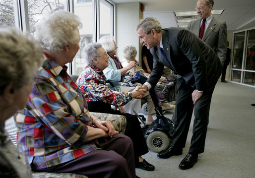 "President George W. Bush and Senator Charles, Grassley, R-Iowa, greet residents at Wesley Acres Senior Center in Des Moines, Iowa, Tuesday, April 11, 2006. The President visited Iowa to talk about the Medicare prescription drug benefits. ""Every senior is saving money, and that's what people have got to know,"" said the President. ""There is an easy way to find out how the program works, and that's to call 1-800-Medicare, or you can go on the computer systems at Medicare.gov."" White House photo by Eric Draper"
