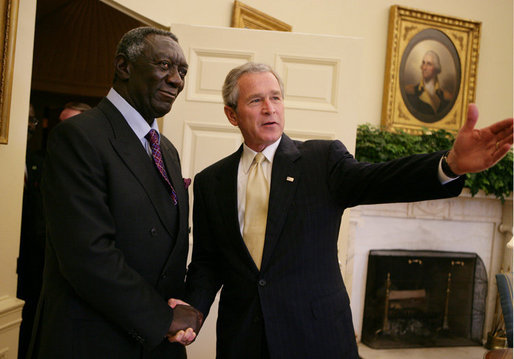 President George W. Bush welcomes Ghana President John Kufuor to the Oval Office at the White House, Wednesday, April 12, 2006, where President Bush complimented President Kufuor as a man of vision, strength and character in his leadership of Ghana. White House photo by Kimberlee Hewitt