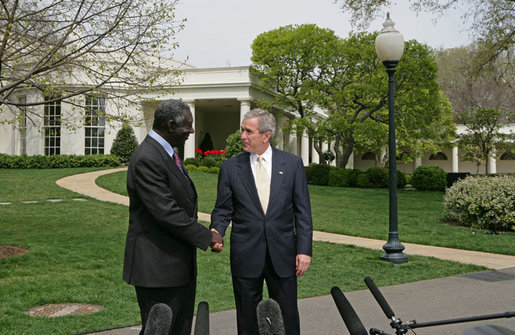 "After meeting in the Oval Office,President George W. Bush and President John Kufuor of Ghana shake hands during a joint statement to the press on the South Lawn Wednesday, April 12, 2006. ""We just had a wonderful discussion about our bilateral relations, and a great discussion about the world. I really enjoy talking to a man of vision and strength and character. President Kufuor has done a fantastic job for Ghana,"" said President Bush. ""He's told the people of his country he'd bring honesty to government, and he has. He told the people of his country that he would work to create a stable economic platform for -- and he has done that, as well. And he's a man of peace. He cares deeply about peace in the region."" White House photo by Kimberlee Hewitt"