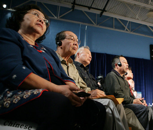 Audience members, some using headphones to hear a translation, listen to President George W. Bush talking to senior citizens at a Conversation on the Medicare Prescription Drug Benefit, Wednesday, April 12, 2006 at the Richard J. Ernst Community Center at Northern Virginia Community College in Annandale, Va. President Bush urged senior citizens to participate in the new Medicare drug benefit program to help reduce their drug costs. White House photo by Kimberlee Hewitt