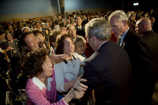 Audience members greet and hug President George W. Bush after his talk about the Medicare prescription drug benefits at the Richard J. Ernst Community Center at Northern Virginia Community College in Annandale, Va., Wednesday, April 12, 2006. President Bush urged senior citizens to participate in the new Medicare program to reduce their drug costs. White House photo by Kimberlee Hewitt