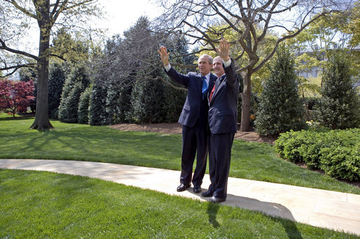 President George W. Bush and White House Chief of Staff Andrew Card wave to the press Thursday, April 13, 2006. Friday is Secretary Card's last day as Chief. Former Deputy White House Chief of Staff Josh Bolten will assume Secretary Card's responsibilities. White House photo by Eric Draper