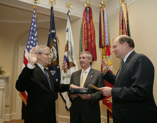New Chief of Staff Josh Bolten is joined by outgoing Chief of Staff Andrew Card as Bolten is sworn-in by Deputy Chief of Staff Joe Hagin, right, Friday, April 14, 2006 in the Roosevelt Room of the White House. White House photo by Paul Morse