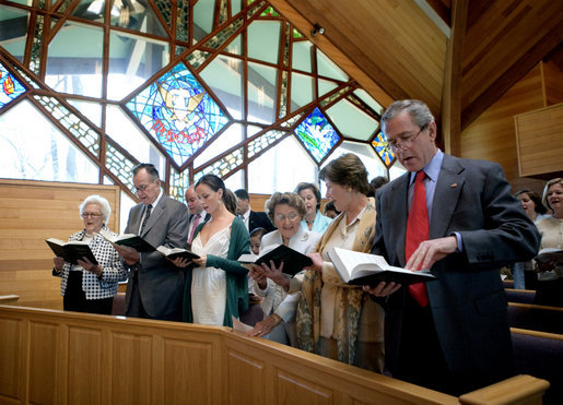 President George W. Bush and Mrs. Bush participate in an Easter service at the Evergreen Chapel at Camp David, Maryland, Sunday, April 16, 2006. Also pictured in front row, from right, are Jenna Welch, Barbara Bush, Former President George H. W. Bush and First Lady Barbara Bush. White House photo by Eric Draper