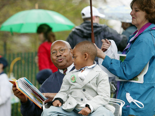 U.S. Secretary of Housing and Urban Development Alphonso Jackson is joined by family friend Willard Jackson Jr., as he reads to a gathering of children at the 2006 White House Easter Egg Roll, Monday, April 17, 2006 on the South Lawn of the White House. White House Photo by Julie Kubal