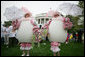White House staff volunteers dressed in festive egg costumes stroll the South Lawn of the White House during the 2006 White House Easter Egg Roll, Monday, April 17, 2006. White House photo by Kimberlee Hewitt