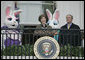 Mrs. Laura Bush and President George W. Bush welcome guests to the 2006 White House Easter Egg Roll, Monday, April 17, 2006, a tradition on the South Lawn of the White House since 1878. White House photo by Paul Morse