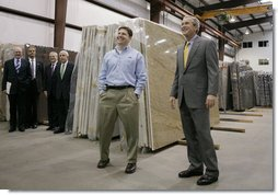President George W. Bush tours the Europa Stone Distributors, Inc. facility in Sterling, Va., with company Vice President Adam Mahmud, Monday, April 17, 2006. Following the tour President Bush, who was joined by U.S. Treasury Secretary John Snow, U.S. Rep. Frank Wolf, R-Va., and White House Chief of Staff Josh Bolten, left, participated in a roundtable discussion on taxes and the economy.  White House photo by Paul Morse