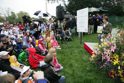 Mrs. Laura Bush reads a story to children attending the 2006 White House Easter Egg Roll, Monday, April 17, 2006 on the South Lawn of the White House. White House photo by Shealah Craighead