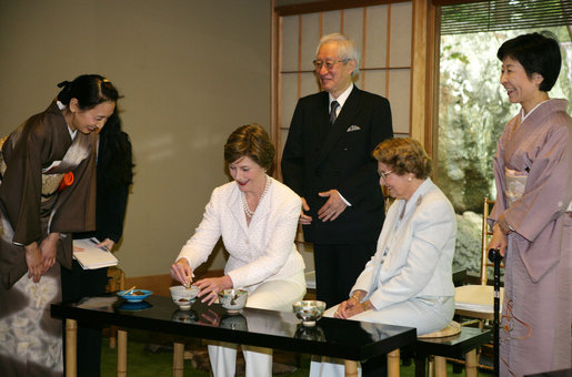 Mrs. Laura Bush, joined by her mother, Mrs. Jenna Welch, right, is given whisking instructions by Ms. Sakiko Akiyama, executive assistant to Grand Master Sen Genshitsu, left, while participating in a Japanese Tea Ceremony, Monday, April 17, 2006, in Washington, DC, with H.E. Ryozo Kato, Ambassador of Japan to the US, and his wife, Mrs. Hanayo Kato. White House photo by Shealah Craighead
