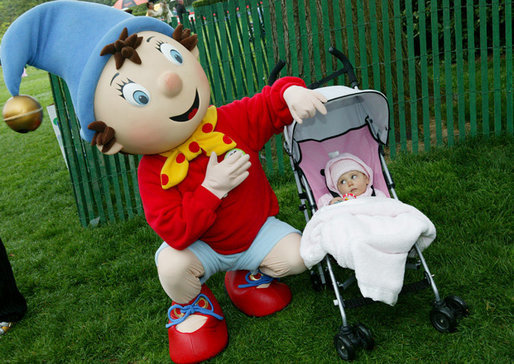 A small child looks up skeptically toward the PBS character Noddy, entertaining kids at the 2006 White House Easter Egg Roll, Monday, April 17, 2006 on the South Lawn of the White House. White House Photo by Julie Kubal