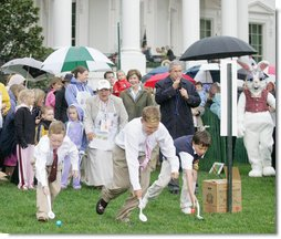 President George W. Bush is joined by Mrs. Laura Bush as he blows a whistle to start an Easter Egg Roll race on the South Lawn of the White House during the annual 2006 White House Easter Egg Roll, Monday, April 17, 2006. The first White House Easter Egg Roll was held in 1878.  White House photo by Kimberlee Hewitt