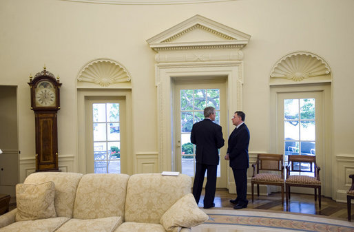 President George W. Bush and Prime Minister Fouad Siniora of Lebanon talk privately in the Oval Office Tuesday, April 18, 2006. White House photo by Eric Draper